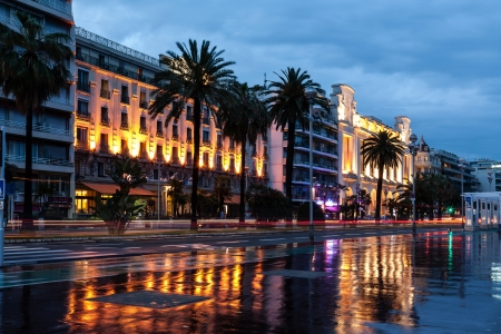 NICE - MAY 21: Promenade des Anglais and the famous Hotel Mediterranee and Casino seen by night from the distance in Nice in France on May 21, 2012.