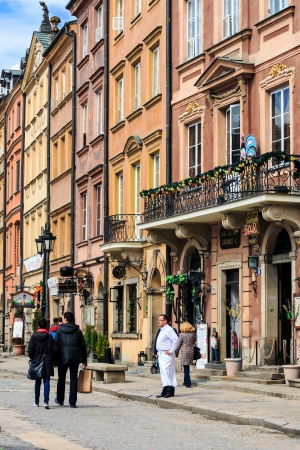 restaurateur: WARSAW - APRIL 13: Townhouses at the Old Town square on the side of Barssa completely destroyed during World War II and reconstructed in the years 1949 - 1953 in Warsaw, Poland on April 13, 2013