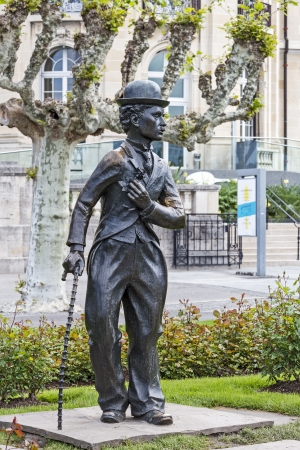 screenwriter: VEVEY - MAY 23: A bronze statue of Charlie Chaplin one of the most creative talents in the era of silent movies, on the promenade reminds passers-by his 25-year stay in the region in Vevey in Switzerland on May 23, 2013