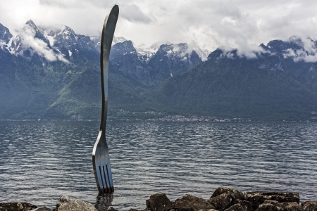 vevey: VEVEY - MAY 23: The Fork, statue made of stainless steel, 8m high and 1.3m wide, designed by Jean-Pierre Zaugg in Vevey in Switzerland on May 23, 2013