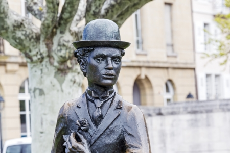 screenwriter: VEVEY - MAY 23: Statue of Charlie Chaplin one of the most creative talents in the era of silent movies, on the promenade reminds passers-by his 25-year stay in Vevey in Switzerland on May 23, 2013