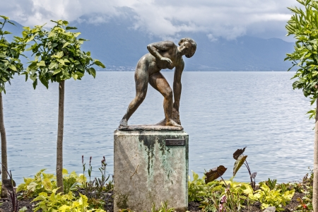 the bather: MONTREUX - MAY 26: Baigneuse ( Bather ), sculpture by Arthur Schlageter (1883 - 1963), set on the banks of Lake Geneva, at the Swiss Riviera in Montreux in Switzerland on May 26, 2013