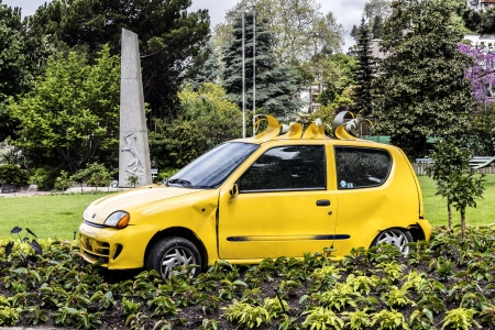 MONTREUX - MAY 20: Fiat Seicento, since 2005 called Fiat 600 produced from 1998 to 2010 in Tychy, Poland by Italian Fiat creates street art on the promenade in Montreux, Switzerland on May 20, 2013