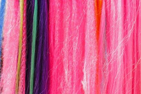 artificial hair: Resumen de antecedentes de cabello artificial multicolor Foto de archivo