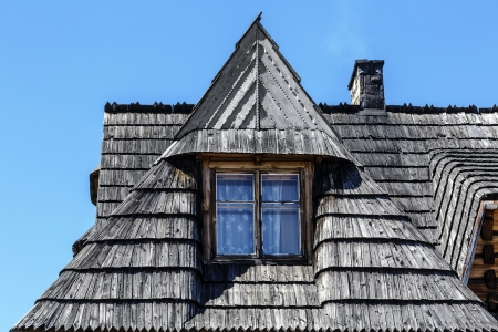 sloping: Traditional sloping roof covered with shingles in Zakopane