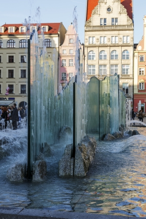 WROCLAW - OCTOBER 06  Modern fountain by Alojzy Gryt built with glass panels in year 2000 on the western side of the old Market Square in Wroclaw in Poland on October 06, 2013