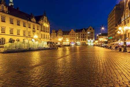 WROCLAW - OCTOBER 08  Old Market Square, built on a rectangle with dimensions of 213 to 178 meters with Modern Fountain by Alojzy Gryt built in year 2000 in Wroclaw in Poland on October 08, 2013
