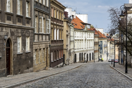 stare miasto: WARSAW - OCTOBER 20  The 200 m long Mostowa Street and the tenements built between 1780 - 1785, burnt down during World War II, and rebuilt in 1951 - 1954, in Warsaw in Poland on October 20, 2013