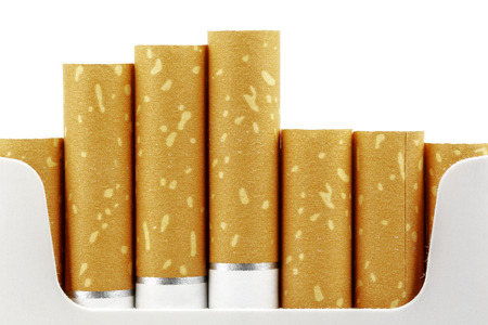 put forward: Cigarette filters put forward from the pack shown up close Stock Photo