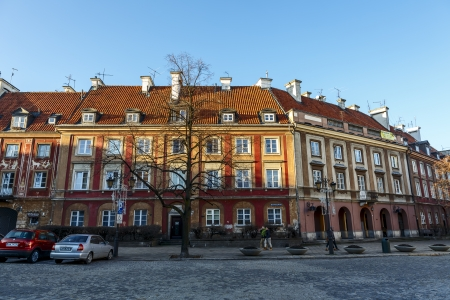 stare miasto: WARSAW - DECEMBER 28: Townhouses of New Town Market at northern frontage, destroyed during World War II in 1944, rebuilt after the war, in Warsaw in Poland on December 28, 2013
