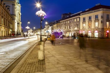 krakowskie przedmiescie: WARSAW - DECEMBER 19: Krakowskie Przedmiescie Street together with the historic center and Wilanow declared a historical monument in the year 1994 in Warsaw in Poland on December 19, 2013
