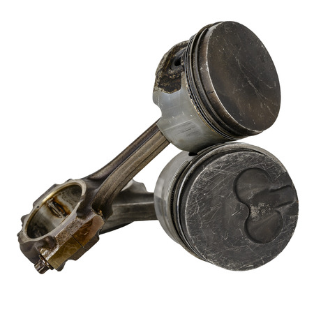 compression  ring: Two worn pistons and connecting rods, dismantled from the internal combustion engine