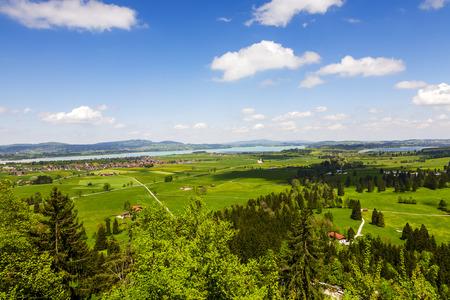 schwangau: Aerial view from Neuschwanstein Castle towards to Forggensee and Schwangau Stock Photo
