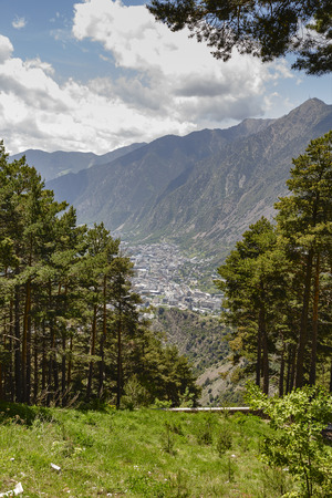 vastness: Andorra la Vella, the town in a valley surrounded by stunning mountains at the Pyrenees in Andorra Stock Photo