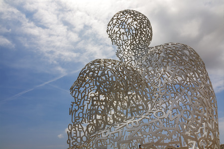 ANTIBES, FRANCE - MAY 30, 2012  Nomade, sculpture by contemporary Catalan artist Jaume Plensa, born in 1955, exposed for viewers at the port of Antibes