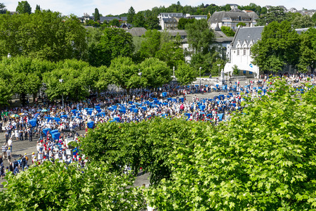 atonement: LOURDES, FRANCE - JUNE 05, 2012  Pilgrims from all over the world, including many people with disabilities in the hope of a miraculous healing come to outdoor Mass at Shrine in Lourdes  Editorial