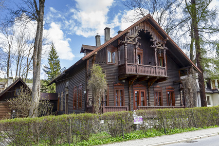 80 s: ZAKOPANE, POLAND - APRIL 20, 2014  Wooden Villa Grabowka III built in Tyrolean style in the 80 s of the 19th century, with historic features listed in the municipal register of architectural heritage