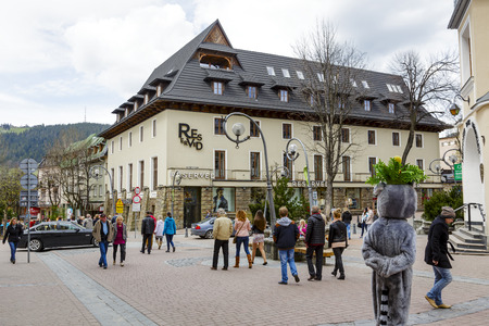 ZAKOPANE, POLAND - APRIL 20, 2014  Brick Building of Giewont Hotel existing since 1955, built according to the design of Juliusz Zorawski, the largest clothing store brand Reserved from June 29, 2013