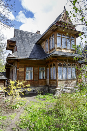 ZAKOPANE, POLAND - APRIL 20, 2014  Made of wood Villa Stokrotka, built around year 1902 with historic features listed in the municipal register of architectural heritage of the city