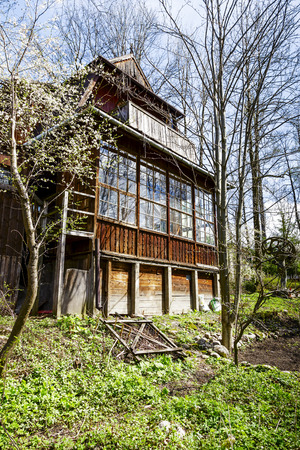 former years: ZAKOPANE, POLAND - APRIL 20, 2014  Wooden Villa built around year 1908, former workshop of the Polish painter Teodor Axentowicz, in the years 1987-2005 Henryk s Burzec art studio