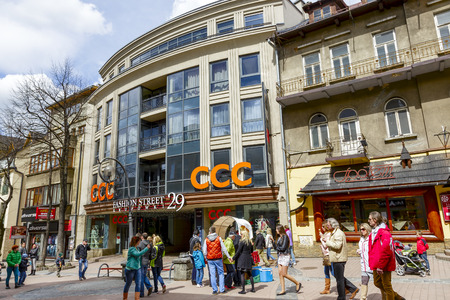 world's: ZAKOPANE, POLAND - APRIL 20, 2014  Gateway to Fashion Street Krupowki 29, shopping avenue length of over 120 meters brings together 43 luxury boutiques of the world s top brands