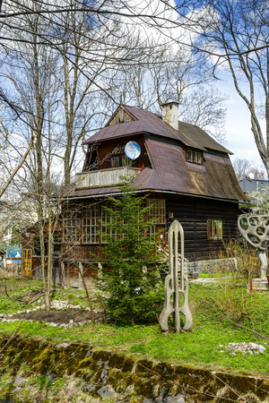 former years: ZAKOPANE, POLAND - APRIL 20, 2014  Wooden Villa built around year 1908, former workshop of the Polish painter Teodor Axentowicz, in the years 1987-2005 Henryk s Burzec art studio
