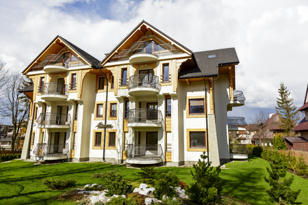 residential house: ZAKOPANE, POLAND - APRIL 20, 2014  The newly built residential House, bears the name of former guesthouse Manaru, in a building designed by architect Stanislaw Topor there are a total of 17 apartments