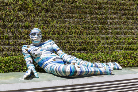 cinta: CANNES, FRANCE - MAY 14, 2014  Re Cinta, sculpture made of painted aluminum by Italian artist Rabarama, alias Paola Epifani, at the exposition in front of the Gallery Cannes Croisette