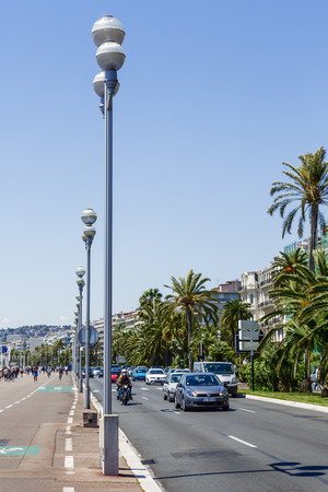 cote d'azure: NICE, FRANCE - MAY 18, 2014  The Promenade des Anglais, the seven kilometers along the coast a favorite place of rest, walking and sport, a symbol of the Cote d Azure