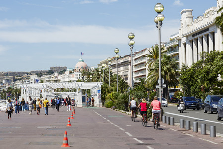 cote d'azure: NICE, FRANCE - MAY 16, 2014  The Promenade des Anglais, the seven kilometers along the coast a favorite place of rest, walking and sport, a symbol of the Cote d Azure