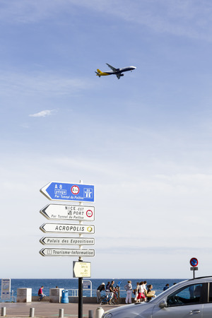 cote d'azure: NICE, FRANCE - MAY 11, 2014  The aircraft flies over the Promenade des Anglais, the seven kilometers along the coast a favorite place of rest, walking and sport, a symbol of the Cote d Azure Editorial