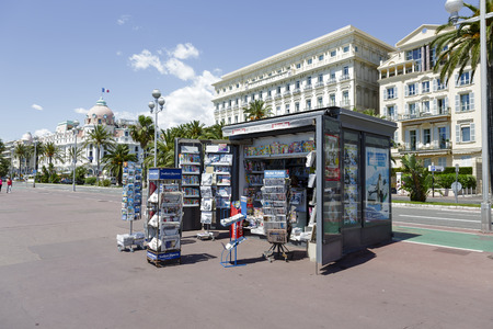 cote d'azure: NICE, FRANCE - MAY 13, 2014  Newsstand offers the latest newspapers and magazines on the Promenade des Anglais, favorite place of recreation at the seven kilometers along the coast of the Cote d Azure