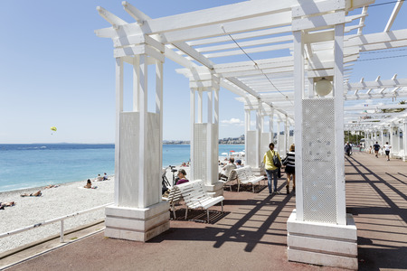 cote d'azure: NICE, FRANCE - MAY 13, 2014  Sunhouse on the Promenade des Anglais, favorite place of walking and sports at the seven kilometers along the coast, the symbol of the Cote d Azure