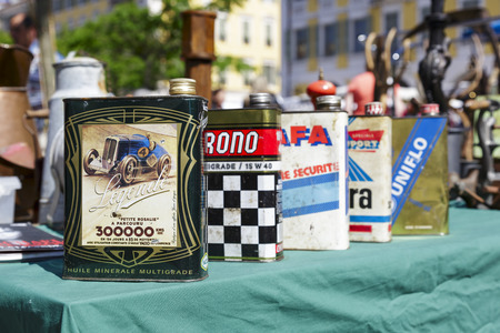NICE, FRANCE - MAY 17, 2014  Old Motor Oil Cans for sale at the antique market, held on Saturdays, on the built late 18th century Garibaldi square, located at the outskirts of the Old Town