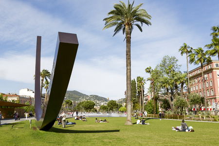 NICE, FRANCE - MAY 11, 2014  Arc de Venet, metal sculpture by Bernar Venet  1988 ,  located in Albert I Gardens next to  the famous Massena Place