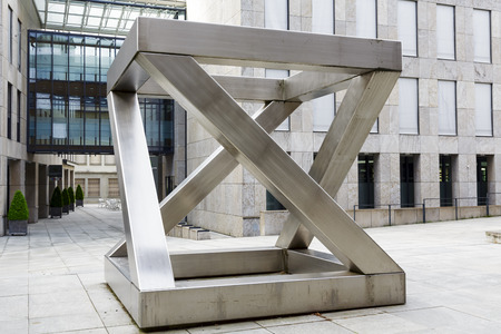 chromeplated: VADUZ, LIECHTENSTEIN - MAY 10, 2014  Z-cube sculpture  1997  made of chrome-plated nickel steel by sculptor Georg Malin, born in 1926 in Mauren  Liechtenstein