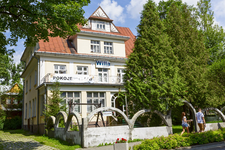 f 18: ZAKOPANE, POLAND - JULY 18, 2014  Villa Gladiola, also called Gerlach, built in 1930 by the project of F  Kotonski, offers 19 guestrooms, listed in the municipal register of architectural heritage  Editorial