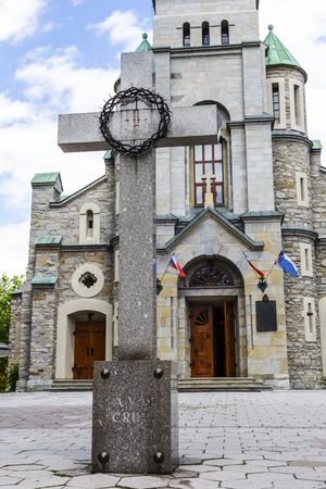 pius: ZAKOPANE, POLAND - JUNE 23, 2014  Cross set prior to Najswietszej Rodziny Church built in 1879-1896 in the Romanesque Revival style by architect Jozef Pius Dziekonski