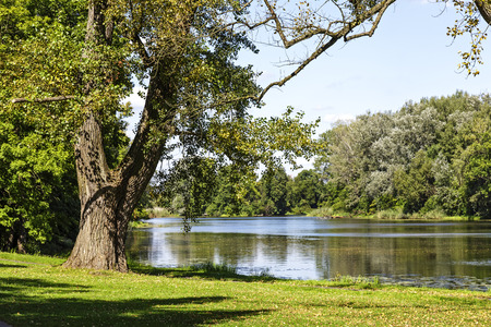 WARSAW, POLAND - AUGUST 20, 2014: Lake, Jezioro Wilanowskie seen from the garden built in the 2nd half of the 17th century and belonging to the suburban residence of King Jan III Sobieski