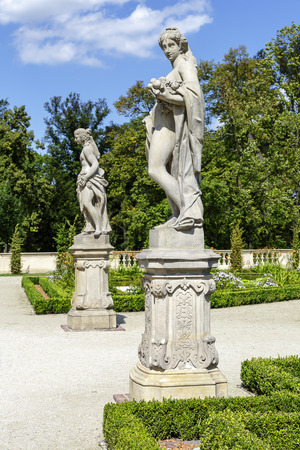 WARSAW, POLAND - AUGUST 20, 2014: Garden Sculptures in the Wilanow park created in the 2nd half of the 17th century together with the Royal Palace built for King Jan III Sobieski Editorial