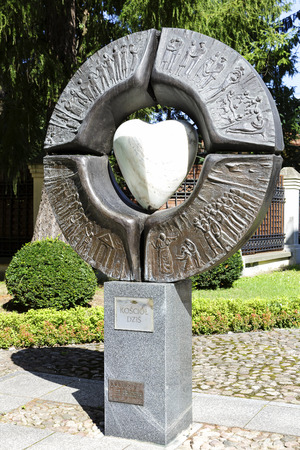 sacral: WARSAW, POLAND - AUGUST 20, 2014: Symbolic sacral sculpture, titled Ecclesia, also known as Church of Today, by sculptor Maria Owczarczyk, located next to the Church of St. Anne in Warsaw