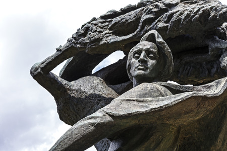 WARSAW, POLAND - AUGUST 25, 2014: Monument to Chopin in Warsaws Lazienki public park depict the composer sitting in masovian stylized willow tree, statue made of bronze