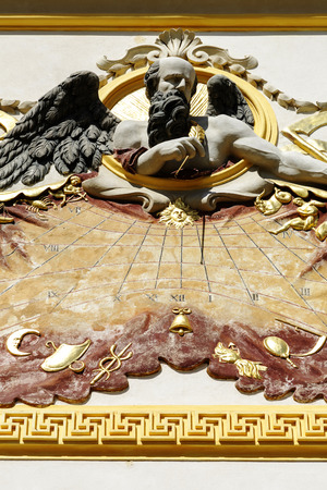 sobieski: WARSAW, POLAND - AUGUST 20, 2014: The sculpture shows the Sundial with Chronos, made of mineral mass around year 1686, decoration of the facade Royal Palace built for King Jan III Sobieski Editorial