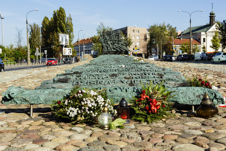 deported: WARSAW, POLAND - SEPTEMBER 24, 2014: Monument unveiled in 1995, it commemorates Poles killed and murdered in the East, deported to labor camps in Siberia and the victims of the Katyn massacre