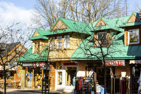 approx: ZAKOPANE, POLAND - OCTOBER 14, 2014: Residential and commercial building, built of wood approx. 1905, located at Krupowki street, listed in the municipal register of architectural heritage Editorial