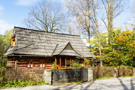 nicknamed: ZAKOPANE, POLAND - OCTOBER 16, 2014: The traditional bicameral house built approx. year 1853 by Jan Gasienica nicknamed Nawsie, the building included on the list of architectural monuments