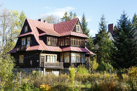 zakopane: ZAKOPANE, POLAND - OCTOBER 14, 2014: Wooden villa called Ros-Ami built in 1937, listed in the municipal register of architectural heritage