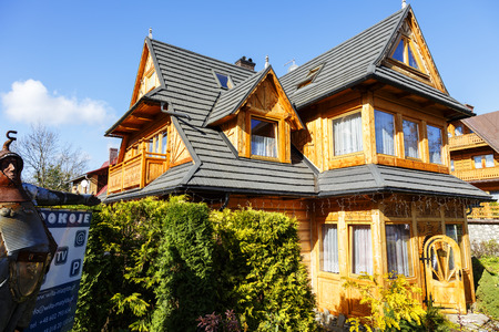 the throughout: ZAKOPANE, POLAND - OCTOBER 14, 2014: Wooden villa named Matylda, its dates back to 1923, offers holiday stays for guests arriving to the city throughout the whole year Editorial