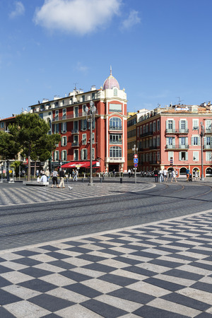frontage: NICE, FRANCE - MAY 18, 2014: Architecture of frontage of Massena Square, seen in the distance, the largest square in the Old Town of Nice, its history goes back to the first half of the 19th century