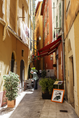 nice  france: NICE, FRANCE - MAY 16, 2014: Narrow streets in the Old Town shows the detail of historic part of the city between Massena Square in the west, Castle Hill on the east and Square Garibaldi